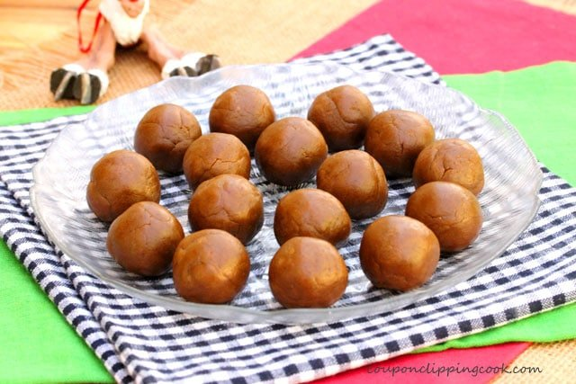 Rolled gingerbread cookie dough balls on plate