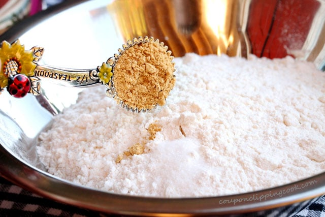 Add ground ginger to bowl with flour