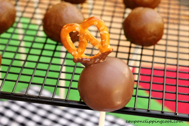 Mini pretzel attached with chocolate to cookie dough truffle on a stick