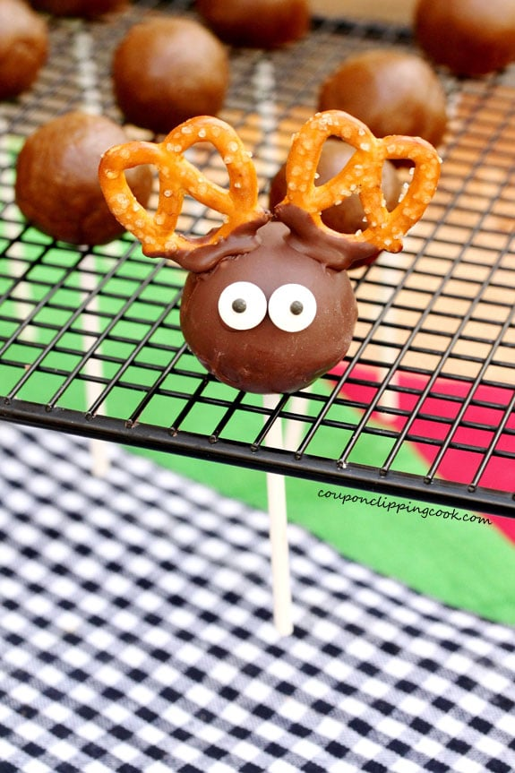 Candy eyes on cookie dough reindeer truffle on a stick