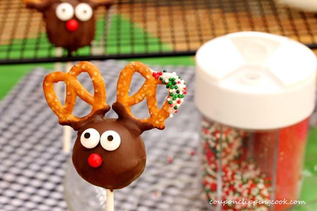 Candy sprinkles on white chocolate mini pretzel on truffle pop