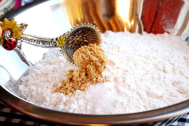 Add ground ginger to flour in bowl