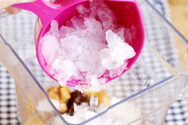 Add crushed ice in blender pitcher