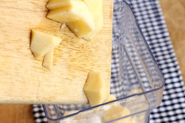 Add cut apples in blender pitcher