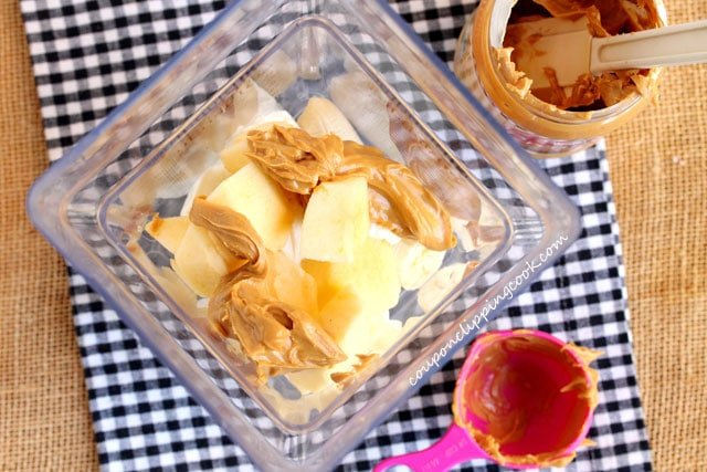 Peanut butter, banana and yogurt in blender pitcher
