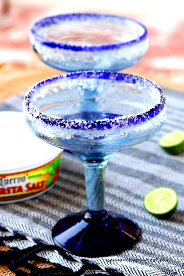 Salted margarita glass rims with lime