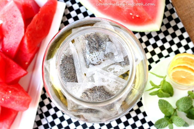 Green tea bags in jar of water