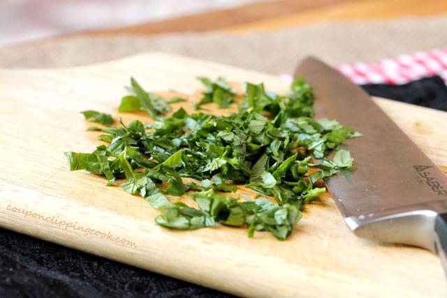 Chopped basil on cutting board with knife