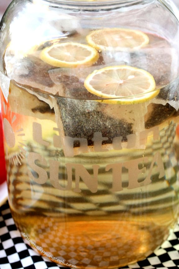 Jar with green tea bags, water and lemon