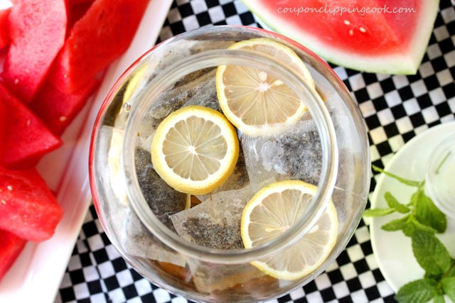 Jar with green tea bags, lemon and water