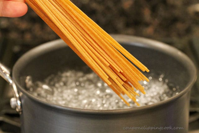 Add linguine pasta to boiling water in pot