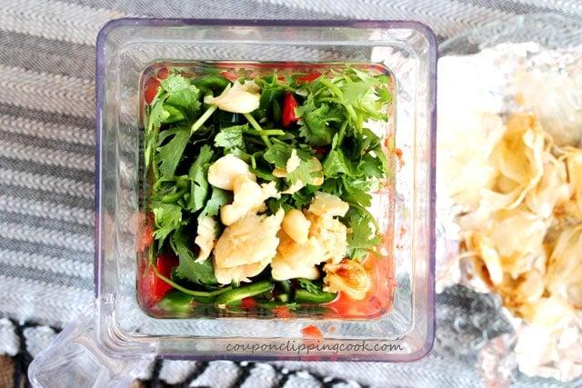 Roasted garlic salsa ingredients in blender