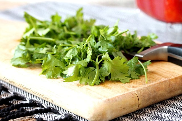 Chopped cilantro on cutting board with knife