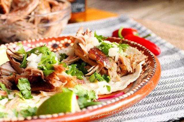 Slow Cooker 3-Ingredient Pulled Pork soft tacos on plate