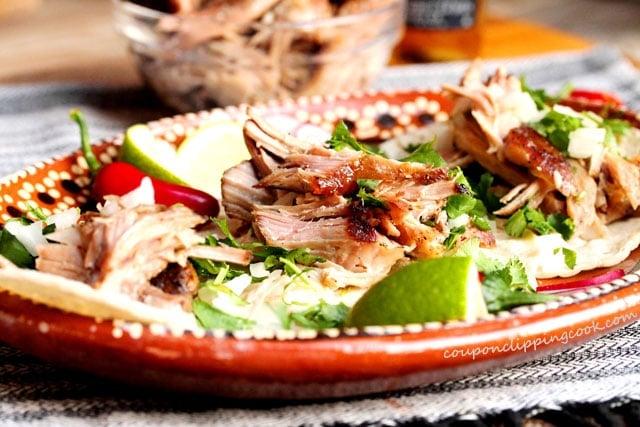 Slow Cooker 3-Ingredient Pulled Pork in corn tortillas on plate