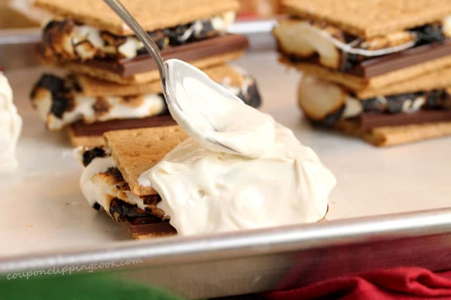 Spread melted candy coating on S'mores on pan