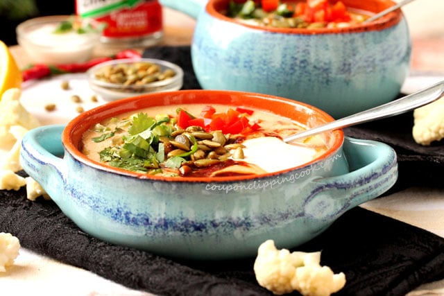 Creamy Roasted Adobo Cauliflower Soup with toppings in bowl