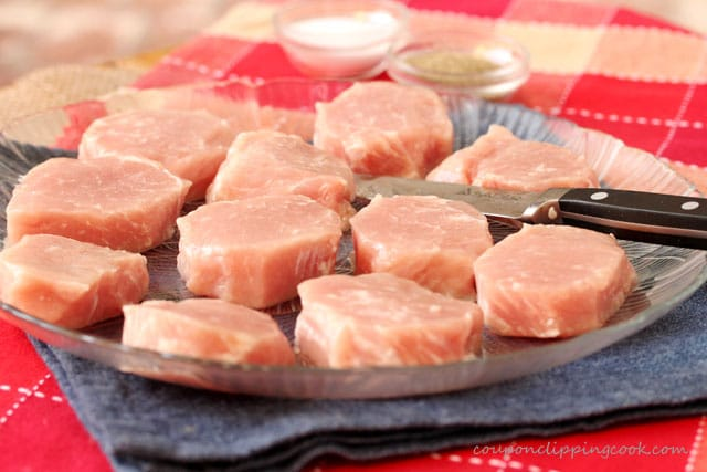 Slices of pork loin on plate with knife