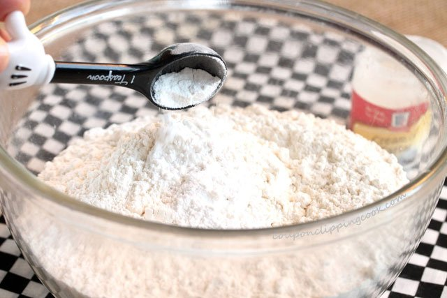 Add cream of tartar to bowl with flour