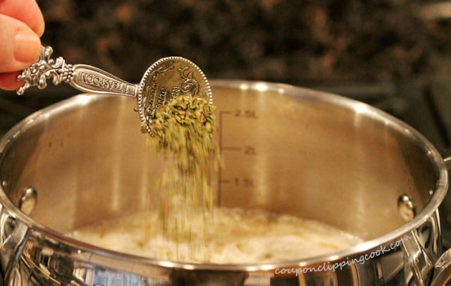 Add dried oregano in soup pot