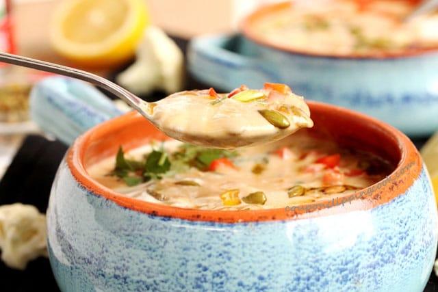 Creamy Roasted Adobo Cauliflower Soup in spoon