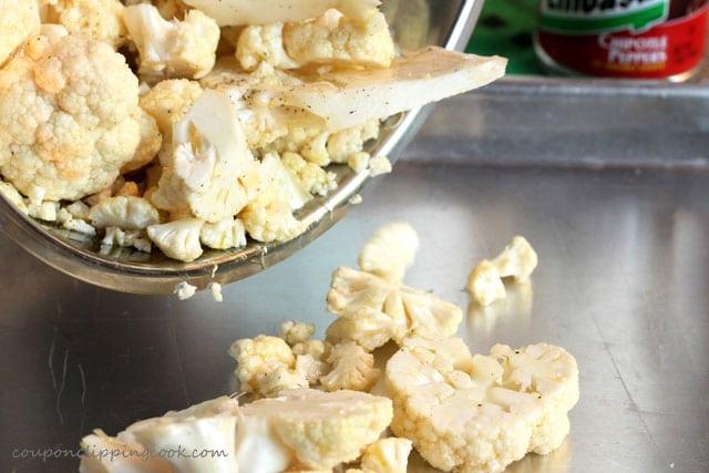 Add cauliflower to baking pan