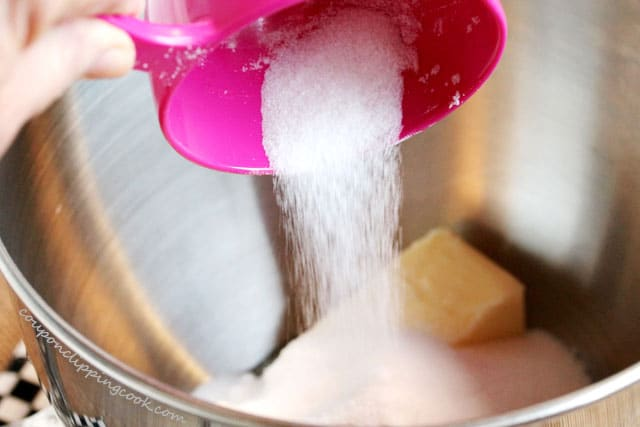 Add sugar to bowl with butter and egg
