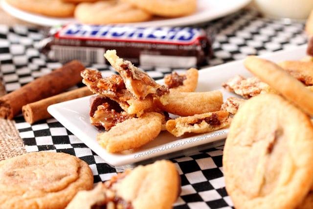 Broken Snickers Snickerdoodle Cookies on plate