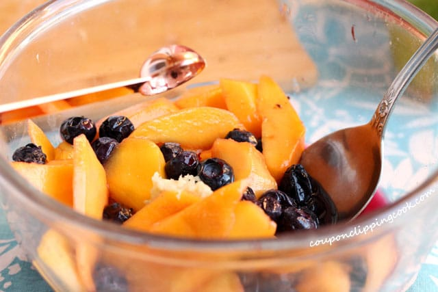 Add grated ginger root in bowl with fruit