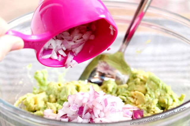 Add chopped red onion in bowl with avocado