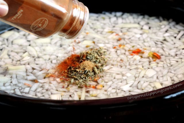 Add paprika to pot with onion and dried beans