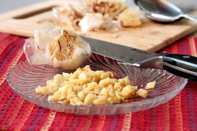 Chopped roasted garlic on plate with knife
