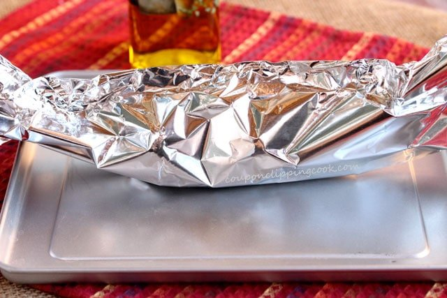 Foil tent with bulbs of garlic inside