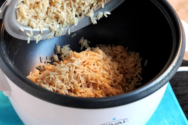Add brown rice to rice cooker pan