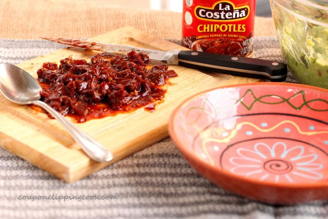 Can of Chipotle and chopped chiles on cutting board with bowl