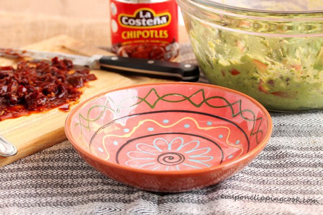 Empty bowl with chopped chiles on cutting board