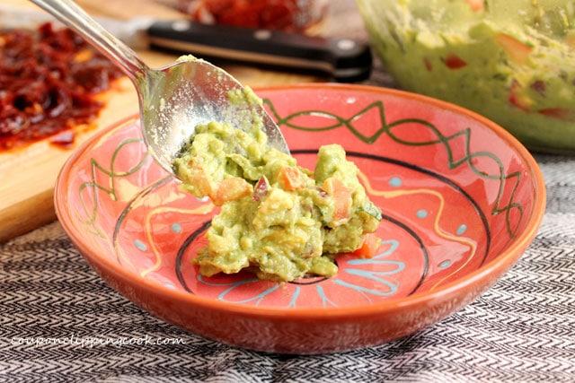 Add guacamole in bowl