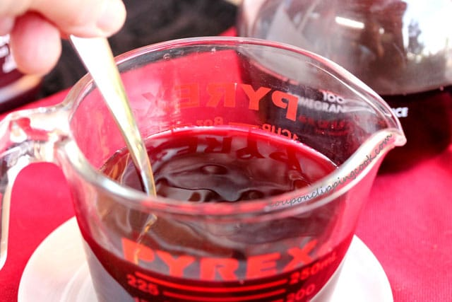 Pomegranate juice and chocolate syrup in glass