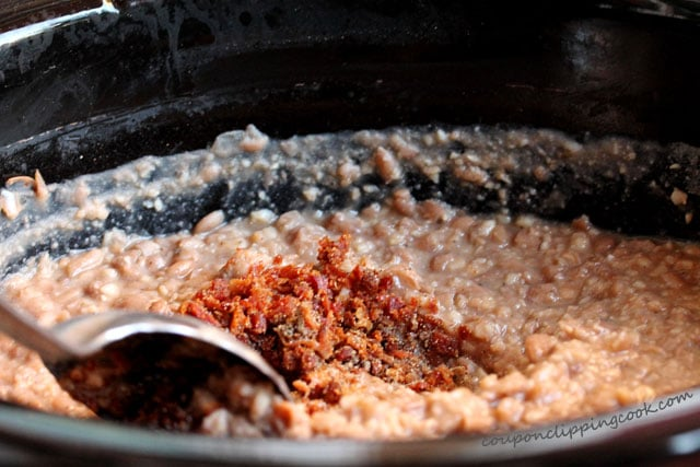 Slow Cooker Roasted Garlic Pinto Bean Mash with Bacon in pot