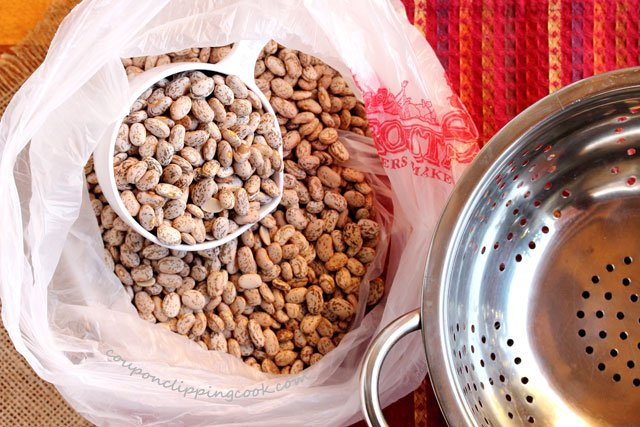 Bag of dried pinto beans and colander