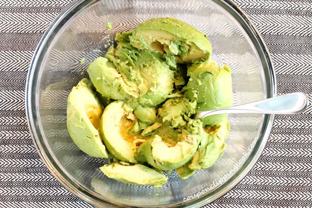 Mash avocado and lime juice in bowl