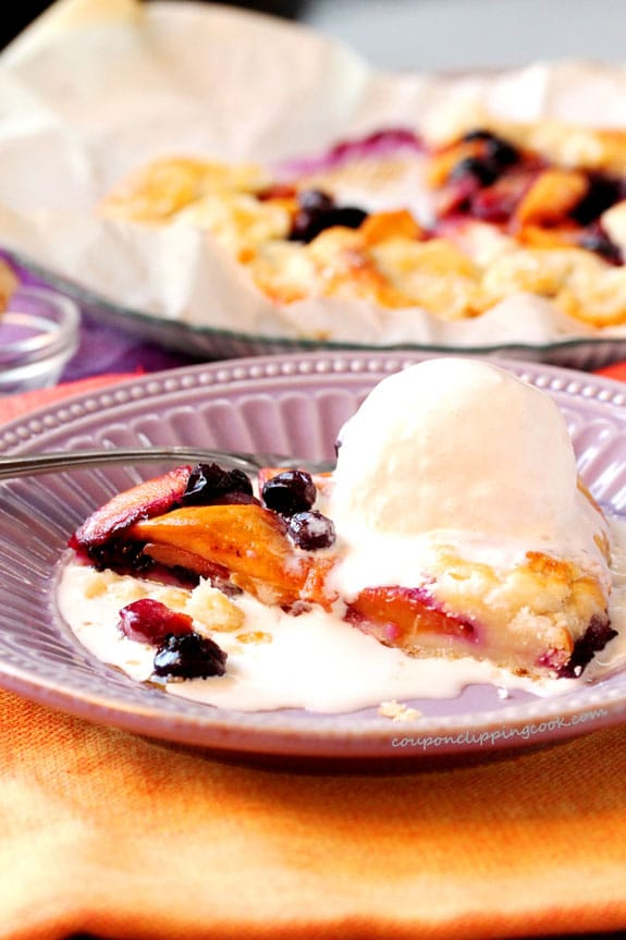 Mango, Blueberry and Ginger Galette with ice cream in bowl