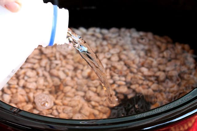 Pour water in pot with dried pinto beans
