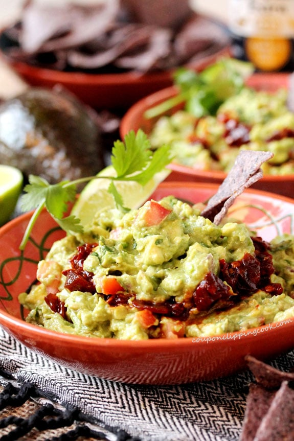Layered Chipotle Guacamole in bowl