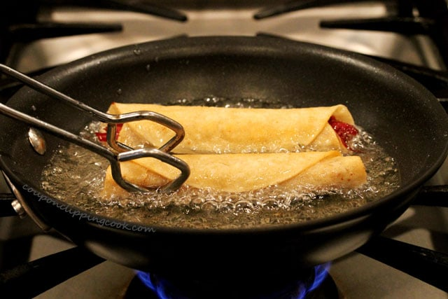 Fry corned beef taquitos in skillet