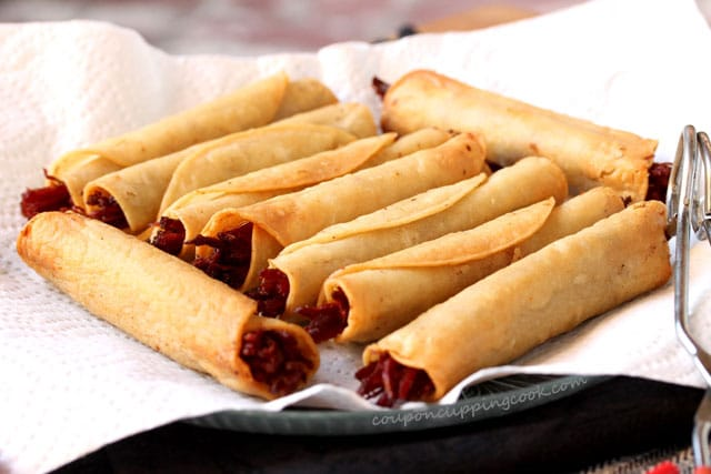 Fried corned beef taquitos on plate with paper towel