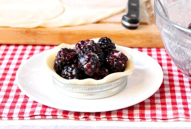 Blackberries on pie crust in mason jar lid