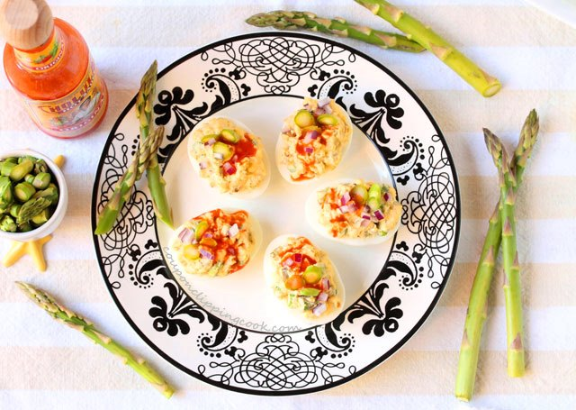 Spicy Deviled Eggs with Asparagus on plate