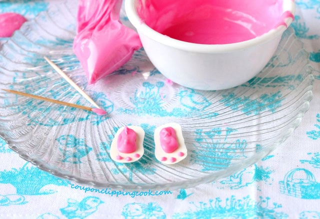 Pink candy foot pads on candy bunny feet on plate