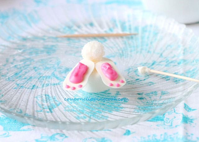 Marshmallow and white chocolate formed bunny feet on plate